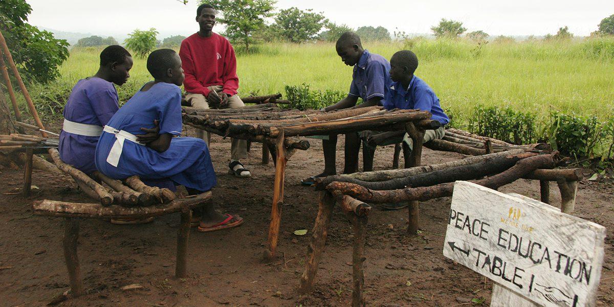 Teacher leads the students in conflict resolution in Kajokeji, South Sudan.