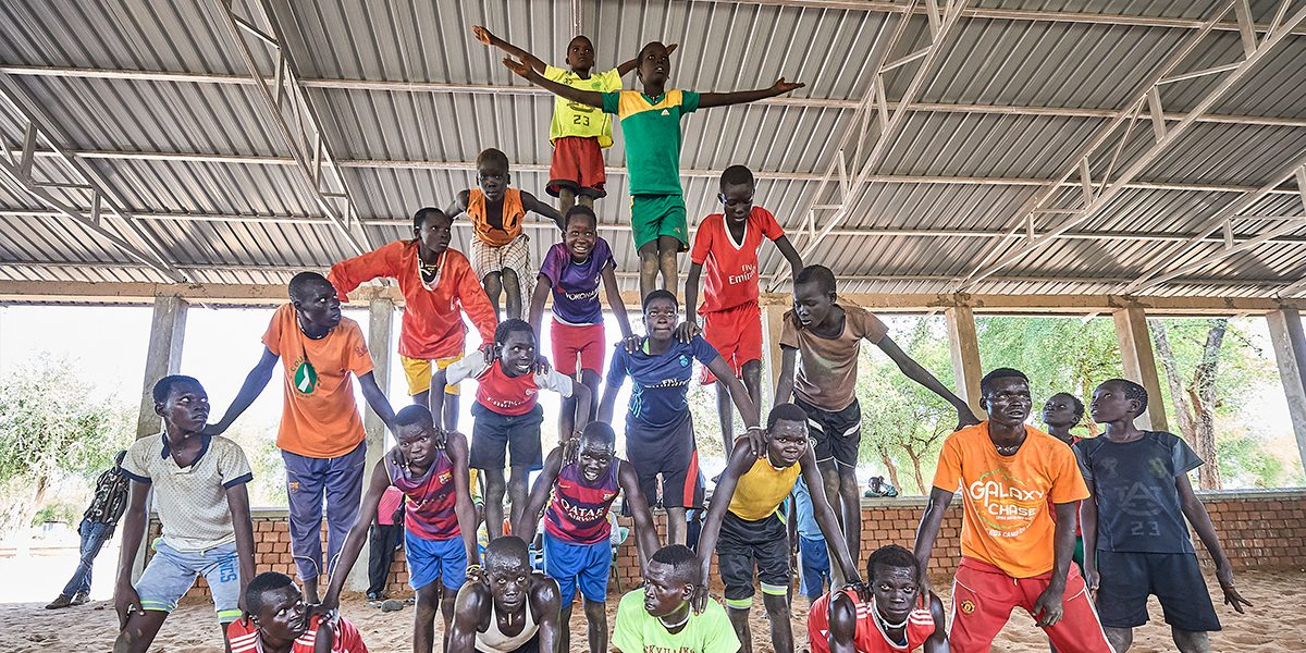 Children form a pyramid as they participate in recreational activities sponsored by Jesuit Refugee Service in the Doro Refugee Camp in Maban, South Sudan.
